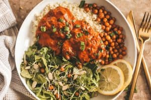 butter chicken with chickpeas and salad