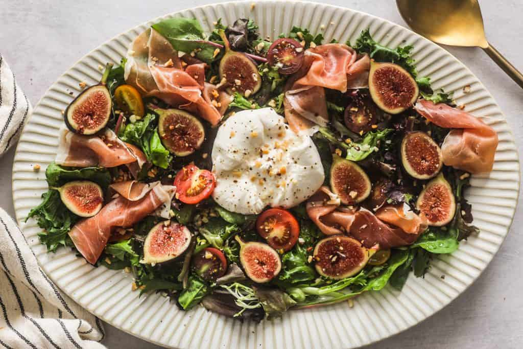 fig and burrata salad on a plate