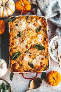 lasagna with pumpkins and plates