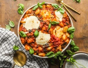 Sausage and Spinach Gnocchi Bake in a bowl garnished with basil