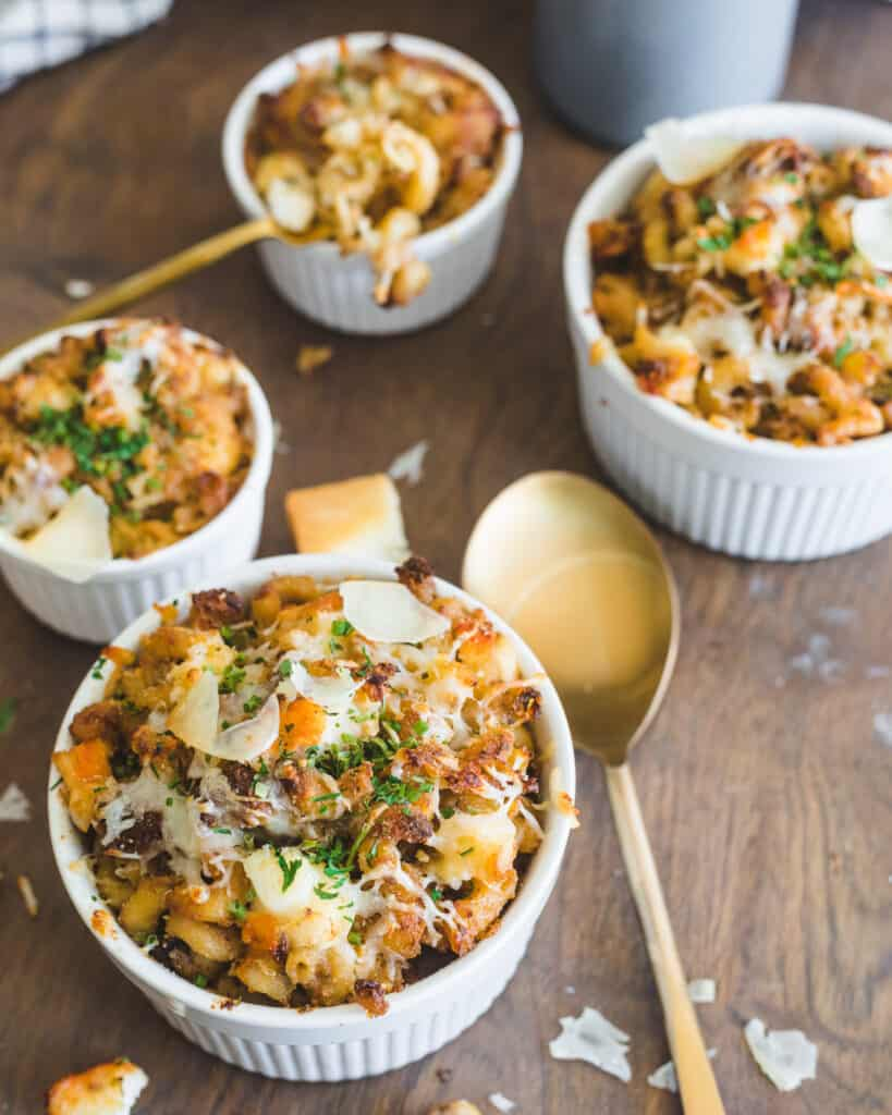 Old Bay Lobster Mac N Cheese in Ramekins garnished with cheese and parsley