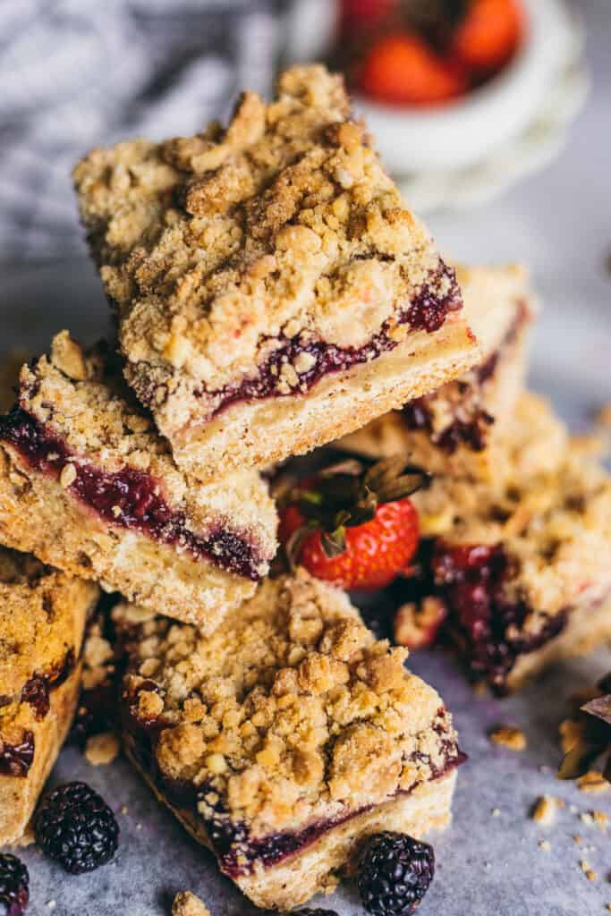 mixed Berry Crumble Bars stacked on top of each other