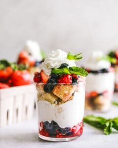 Mixed Berry Trifles in a cup with berries and spoons