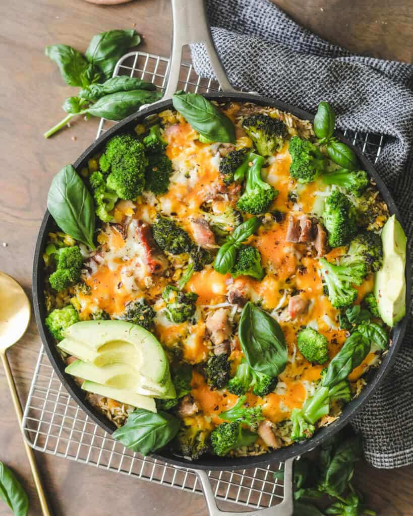 Easy Chicken Broccoli and Cheese Casserole on a cooling rack with a dish cloth
