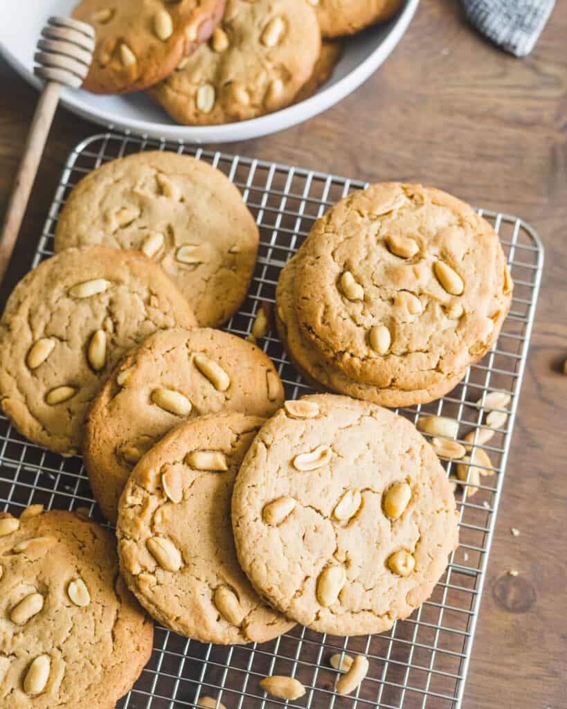 Honey Peanut Butter Cookies on a cooling rack with a cloth