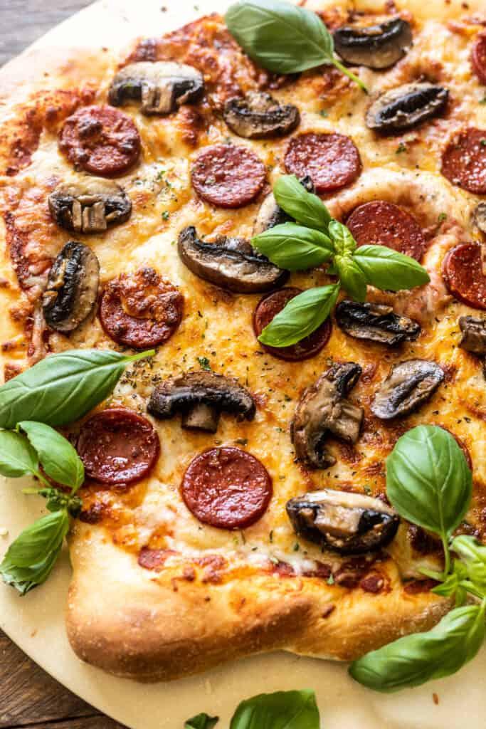 Roasted Mushroom and Pepperoni Pizza on a pizza stone