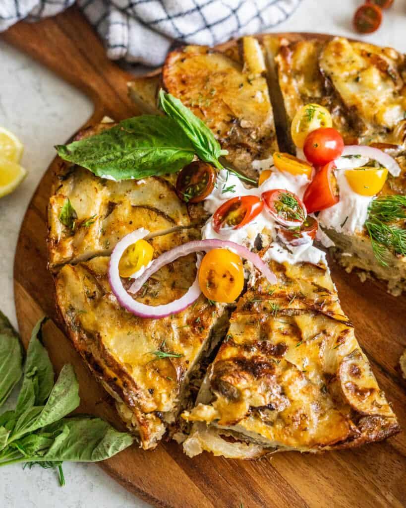 Fresh Herb Spanish Tortilla on a cutting board