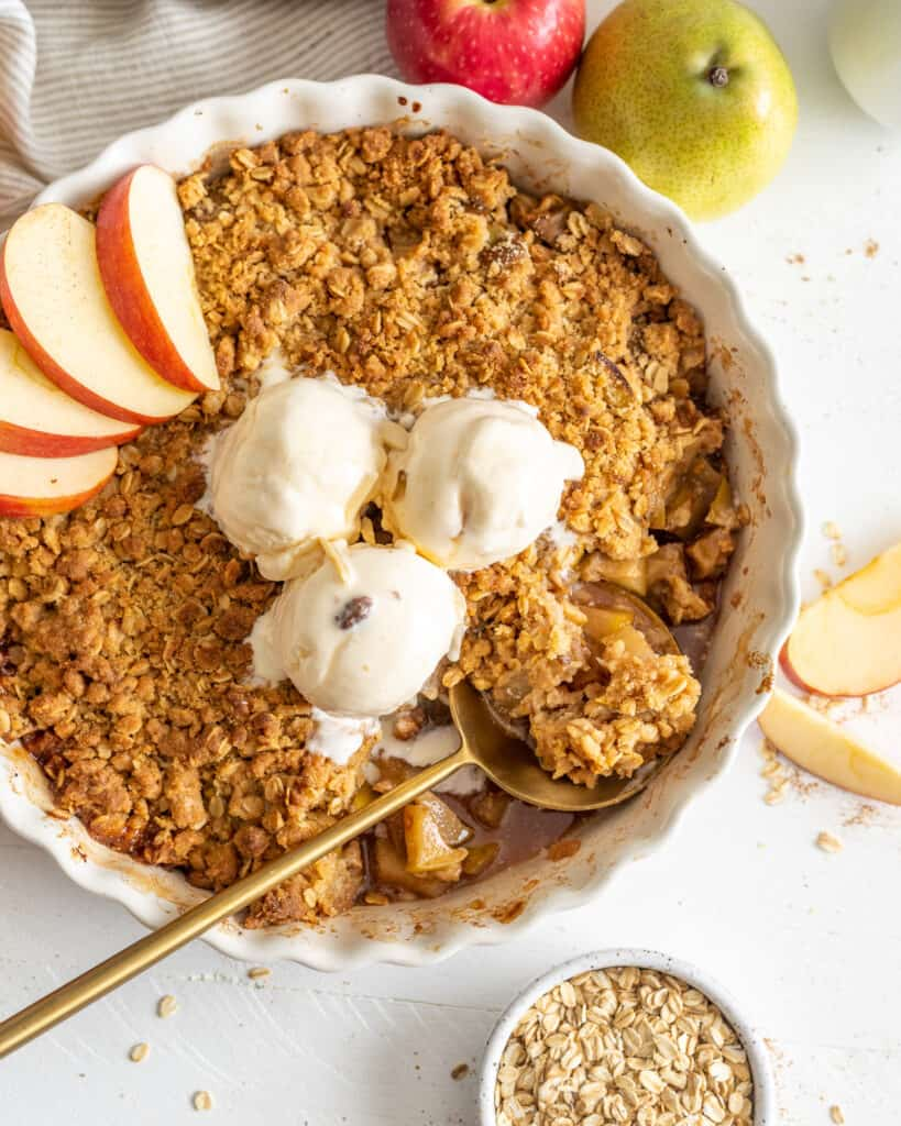 Cinnamon Pear Apple Crisp on a plate with a spoon