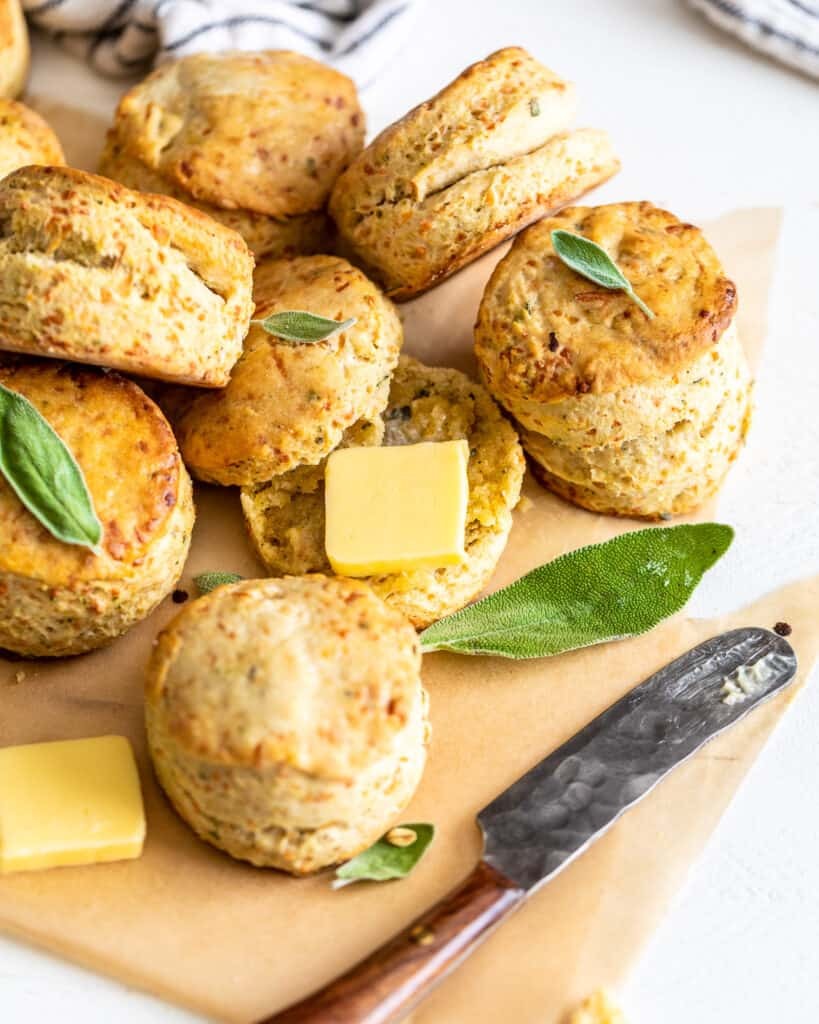 biscuits laid out on a flat surface with sage leaves