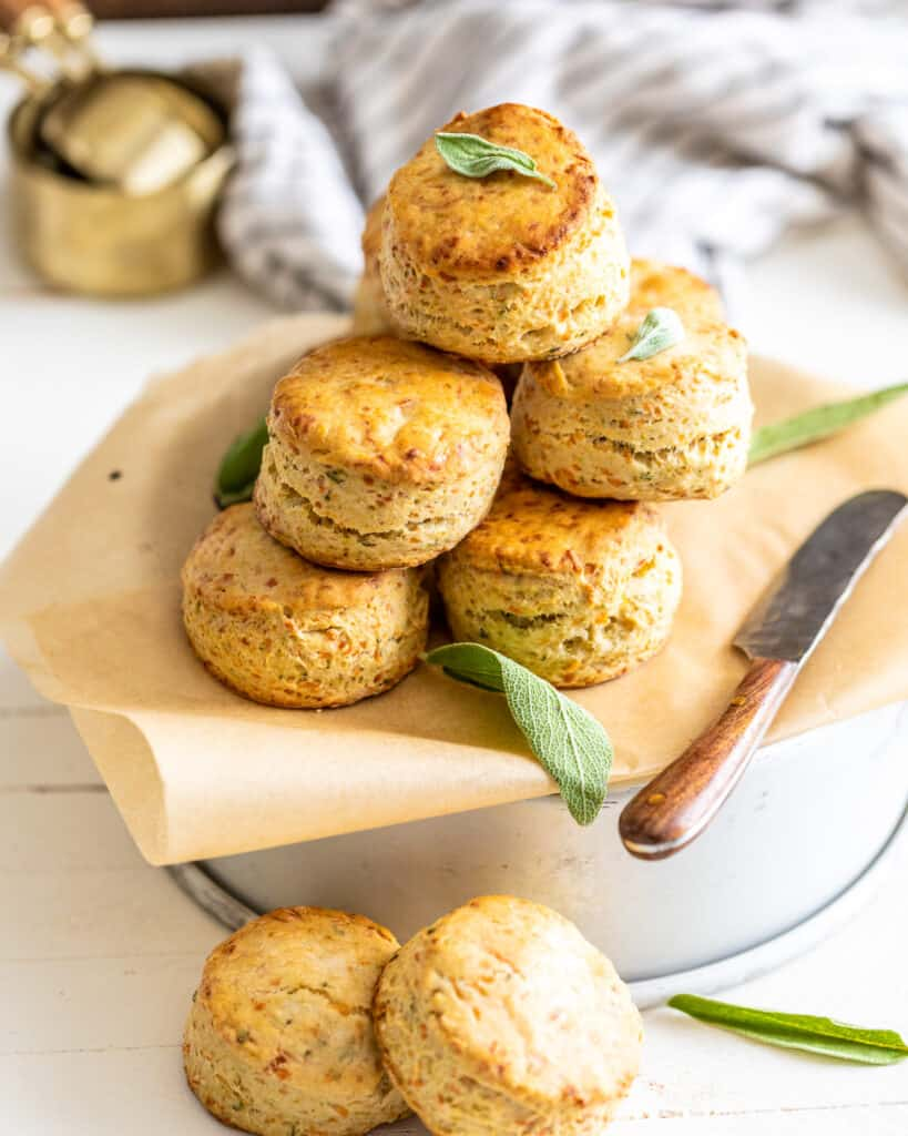 biscuits stacked on top of each other with sage leaves