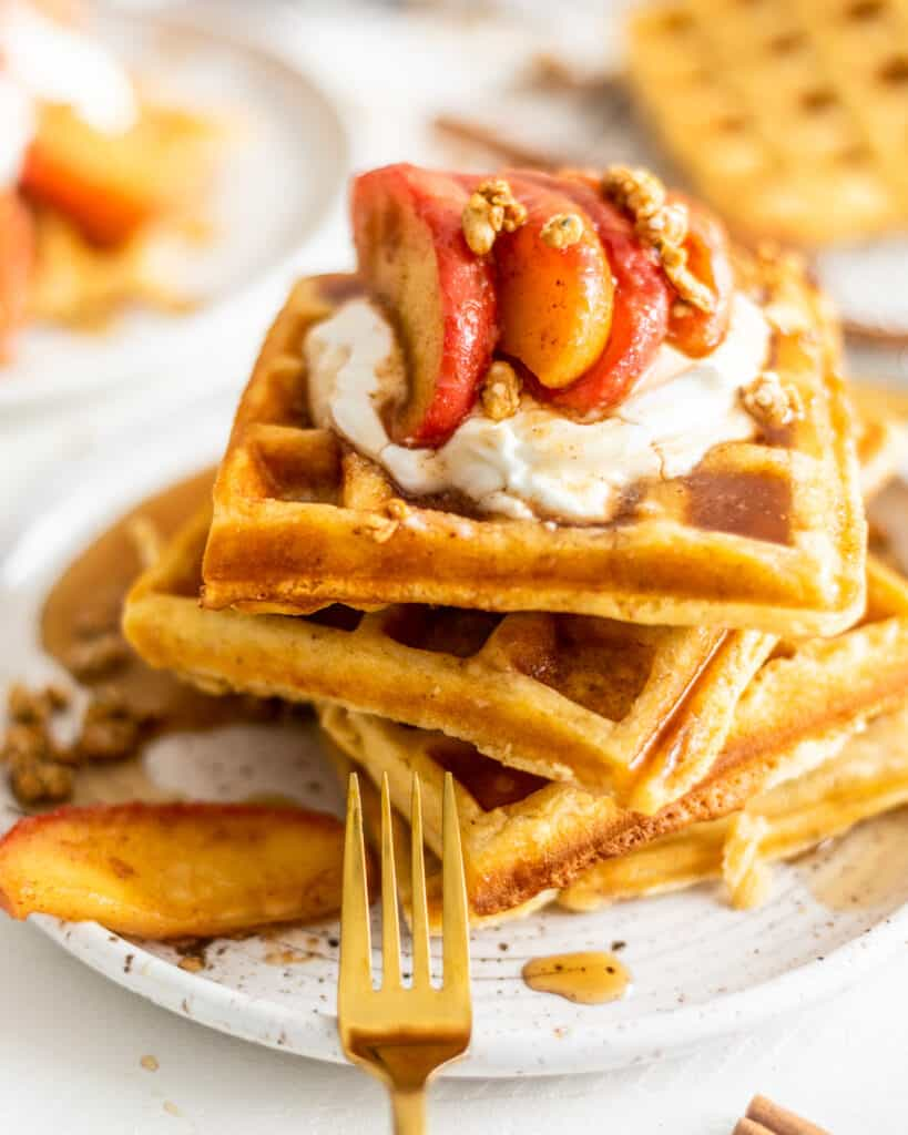 up close shot of waffles with cinnamon apples