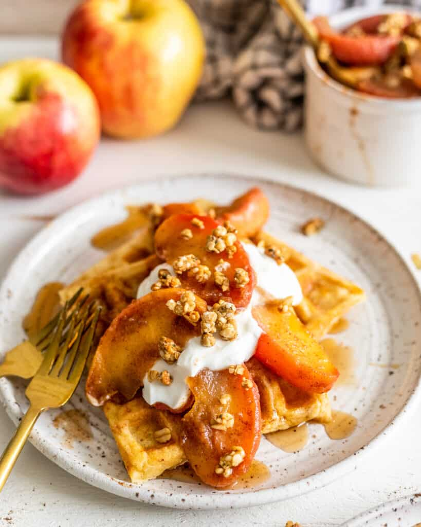 brown butter waffles with cinnamon apples on a plate