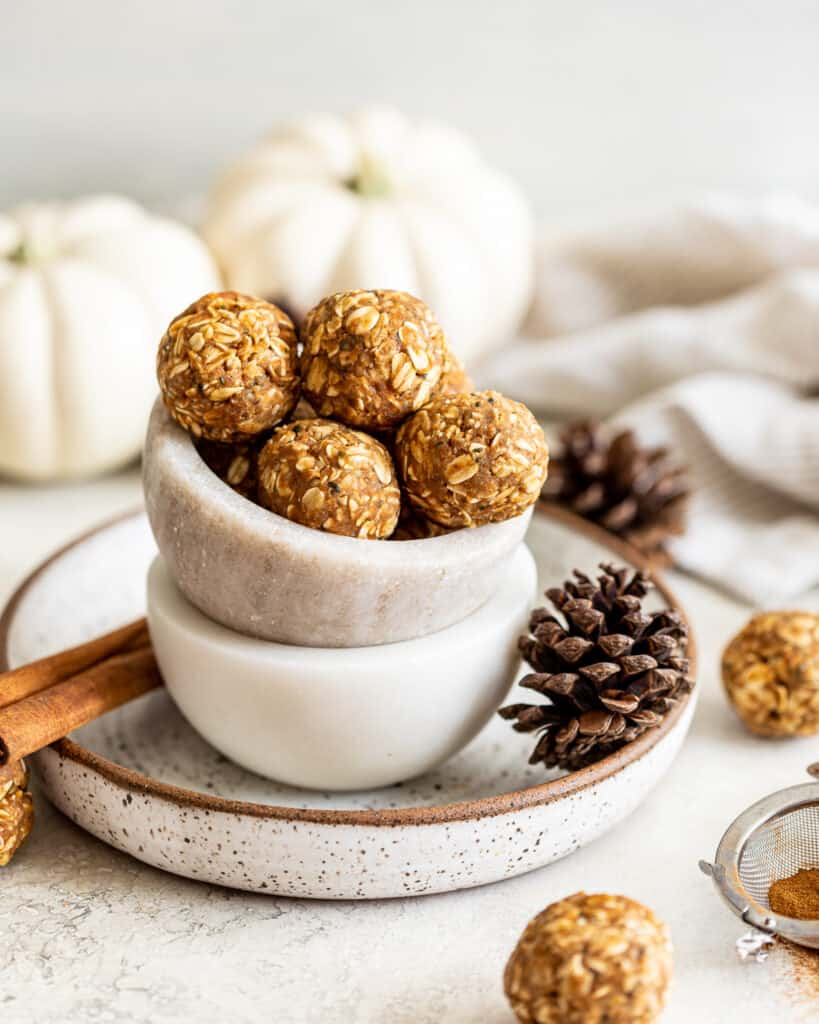 front photo of chai spiced energy bites with pumpkins in the background