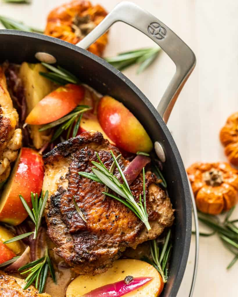 Rosemary Apple Cider Chicken in a calphalon pan